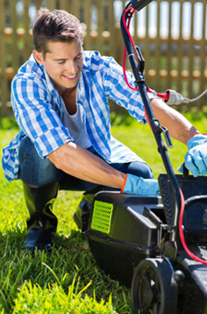 Emptying Lawnmower Grass Catcher after Mowing the Lawn